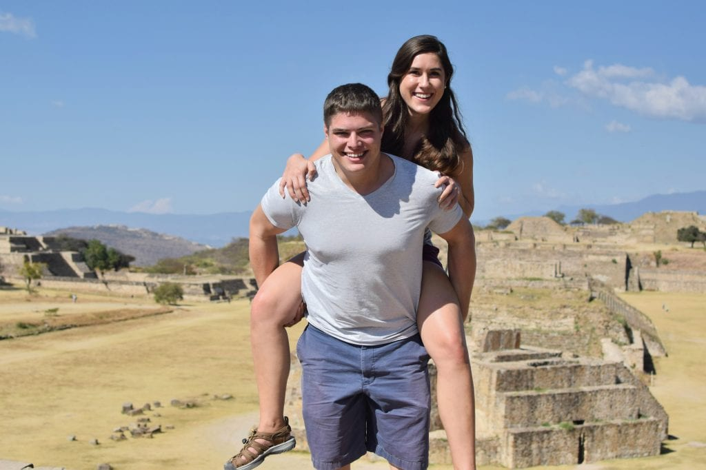 Kate Storm and Jeremy Storm at Monte Alban in Oaxaca Mexico--exploring lots of ruins like this is one of our top tips for traveling to Mexico!