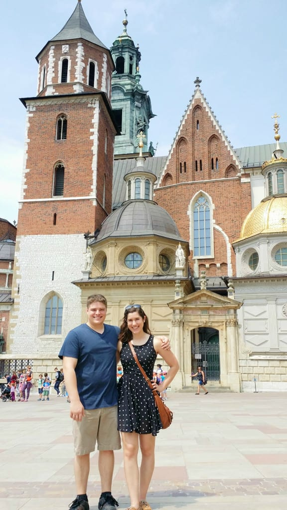 Kate Storm and Jeremy Storm standing in front of Wawel Cathedral when visiting Krakow Poland