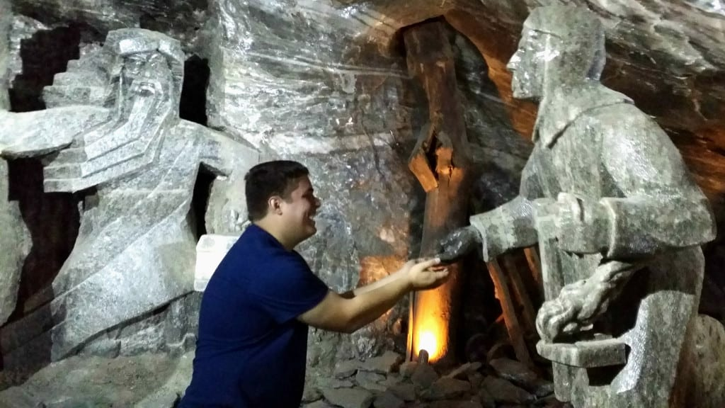 Jeremy Storm posing with statues in the Wieliczka Salt Mine during a couple days in Krakow Poland