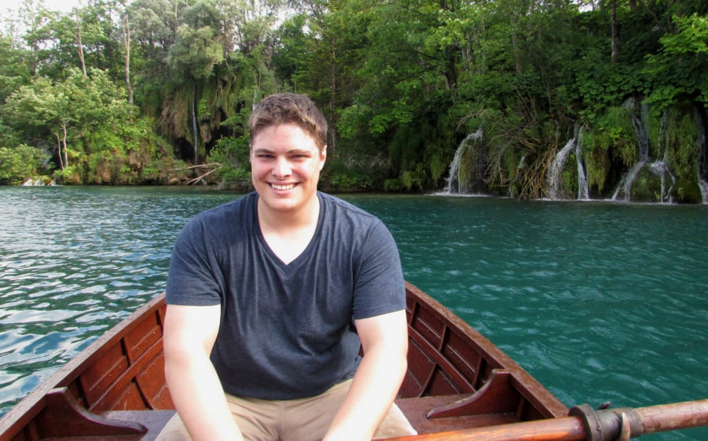 Jeremy Storm rowing across a lake in Plitvice Lakes Croatia