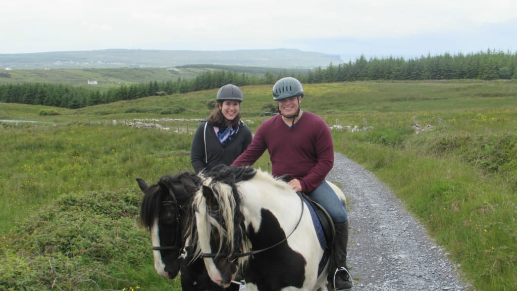Kate and Jeremy horseback riding near Doolin Ireland in 2015--taking a horseback ride here is one of the best things to do in Doolin!