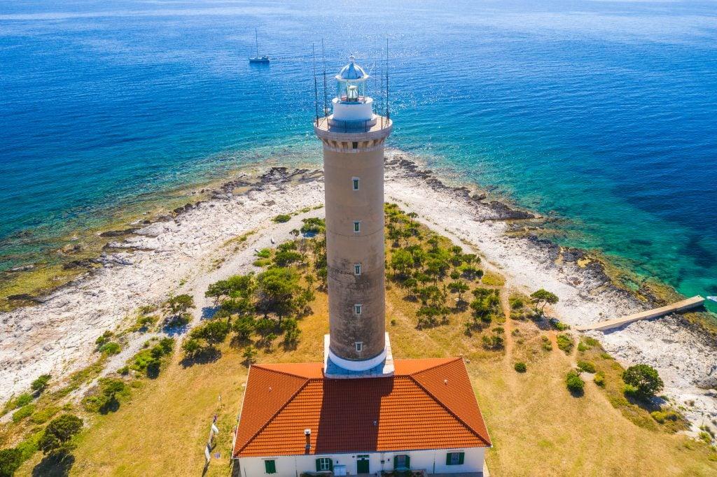 beach on dugi otok croatia near zadar with lighthouse in the foreground