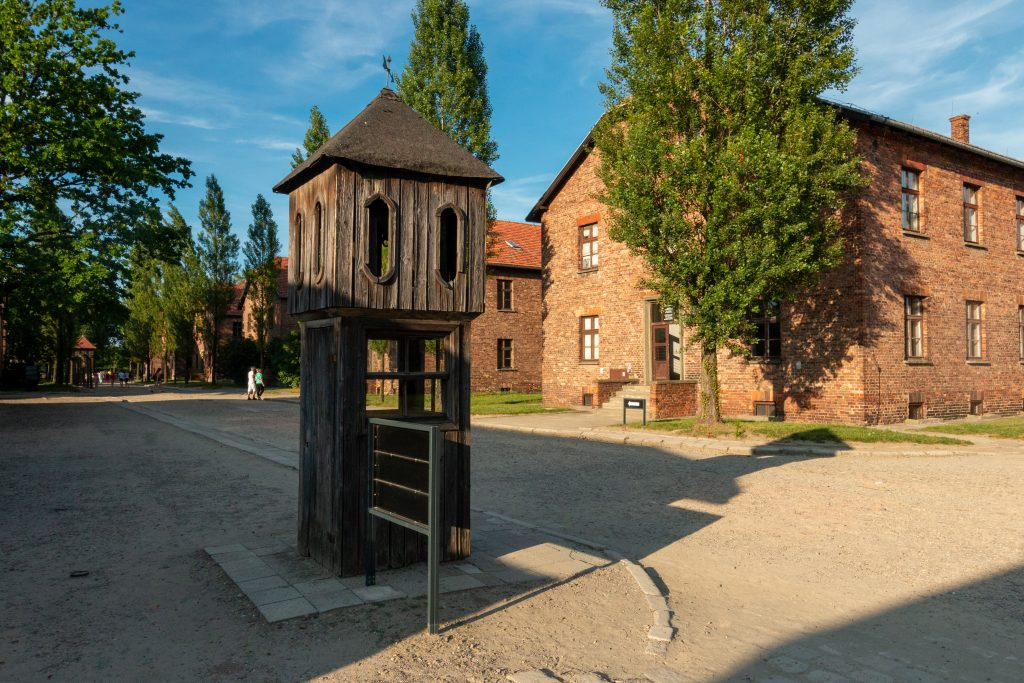 grounds as seen on an auschwitz tour with brick buildings in the background