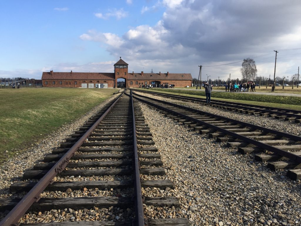 birkenau train station as seen in the distance from railroad tracks