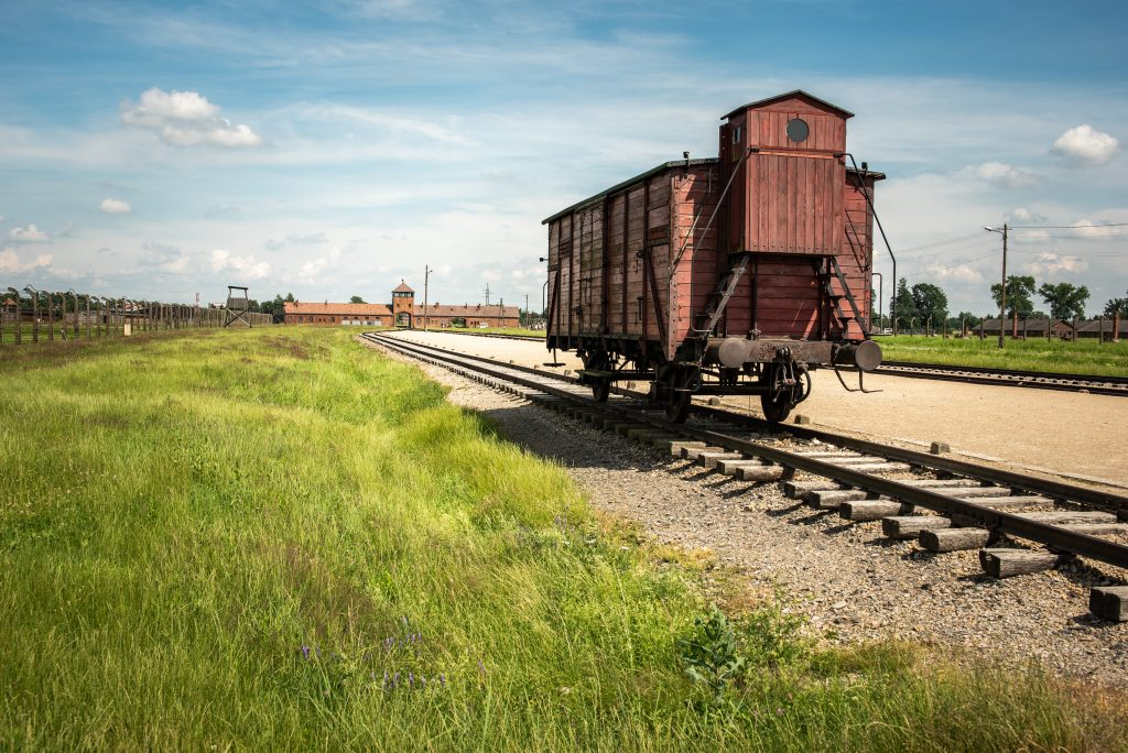 red train car parked at birkenau concentration camp