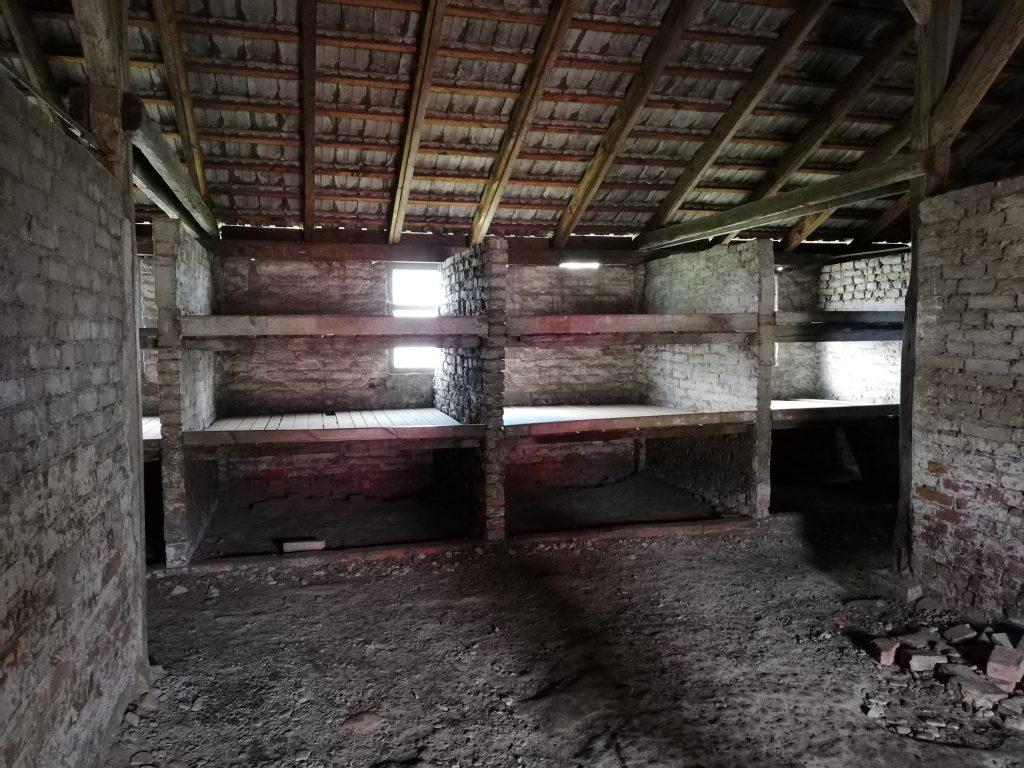 barracks in birkenau concentration camp showing prisoner sleeping pallets