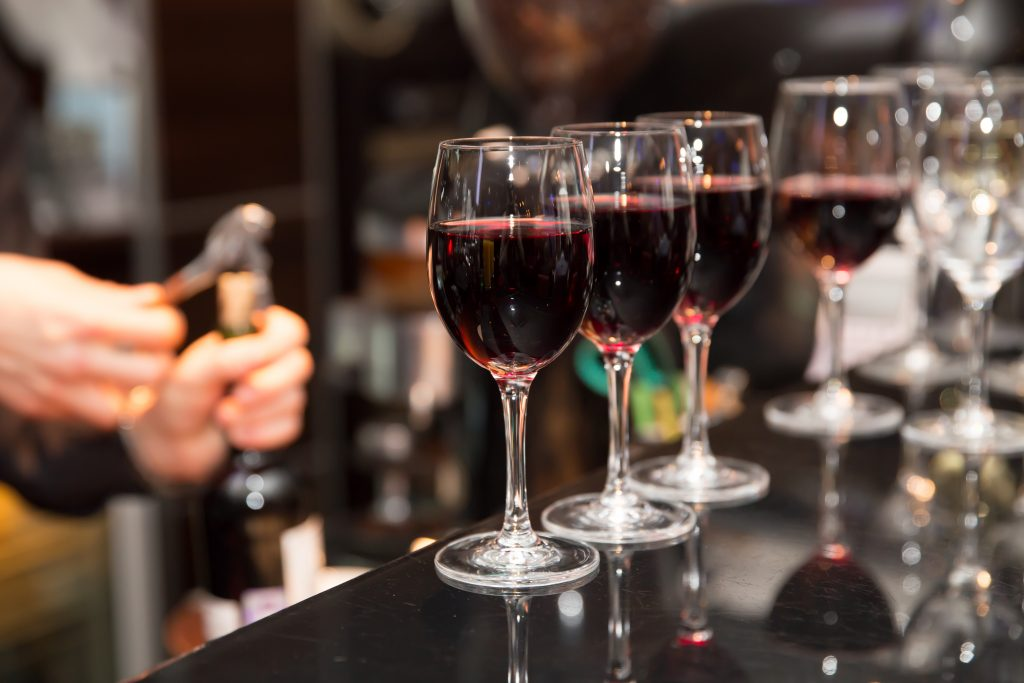 4 glasses of red wine at paris wine tasting, one of the fun things to do in paris france