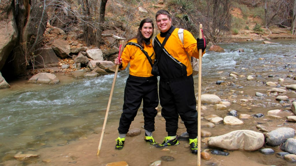 Kate Storm and Jeremy Storm wearing dry suits to hike the Narrows in Zion National Park