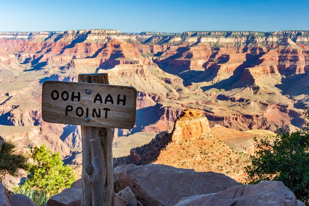 ooh aah point in grand canyon national park with wood sign in foreground