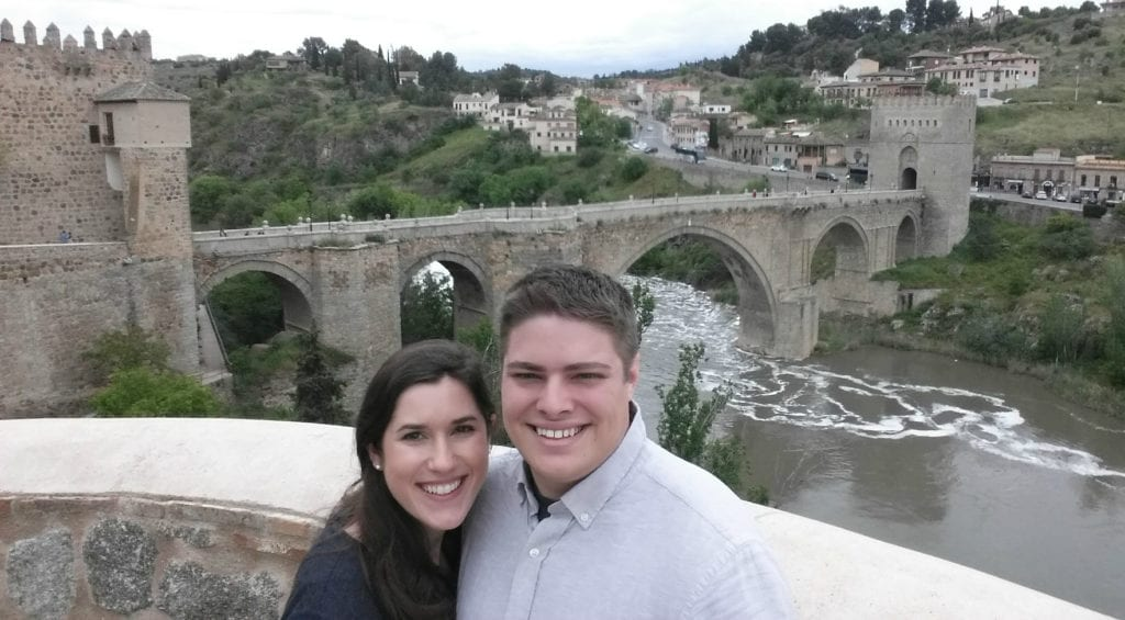 Kate Storm and Jeremy Storm taking a selfie with San Martin Bridge during one day in Toledo Spain