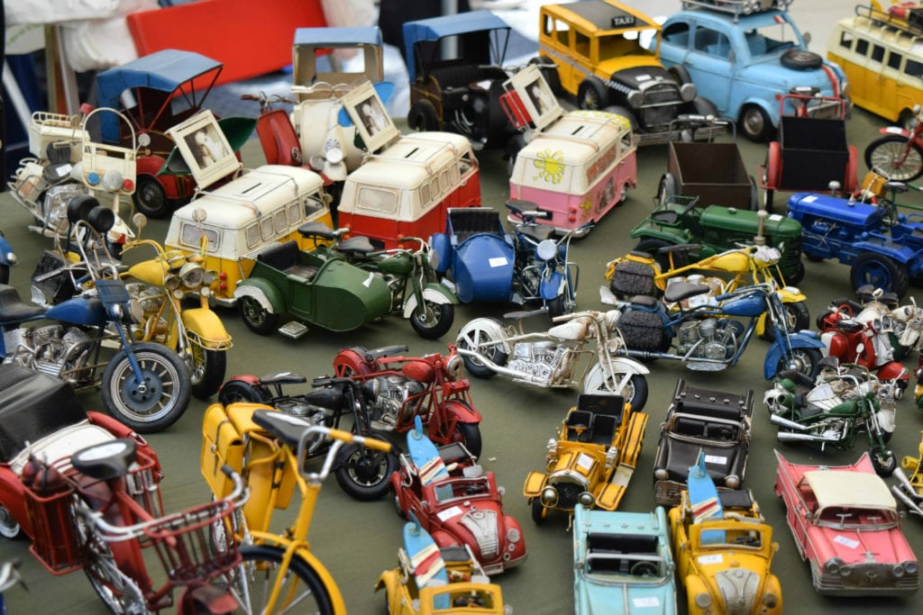 Table of small toys being sold at El Rastro Madrid Spain