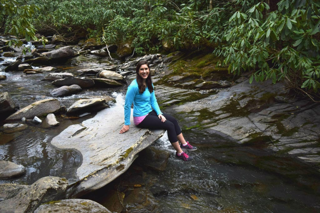 Kate Storm hiking in Great Smoky Mountains National Park, one of the best east coast USA road trip routes.