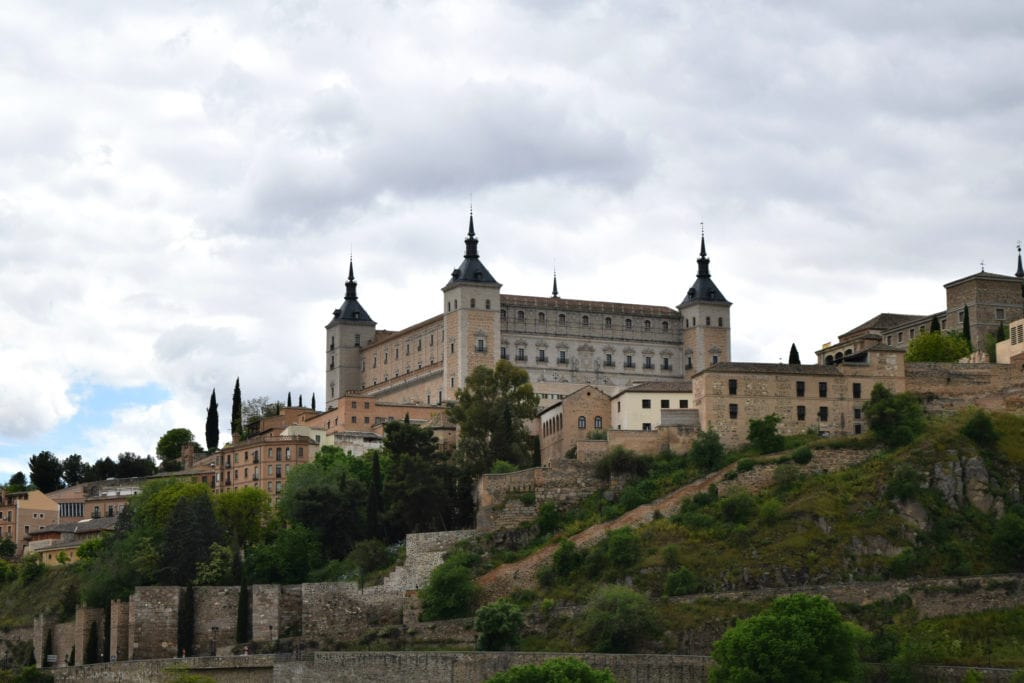 Alcazar of Toledo as seen from across the Tagus River on a Madrid to Toledo day trip