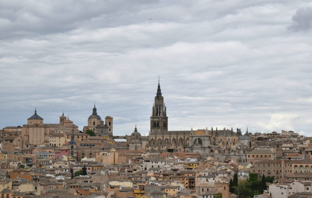 View of the roofs of Toledo from across the Tagus River, as seen on a Madrid to Toledo Day Trip on a cloudy day