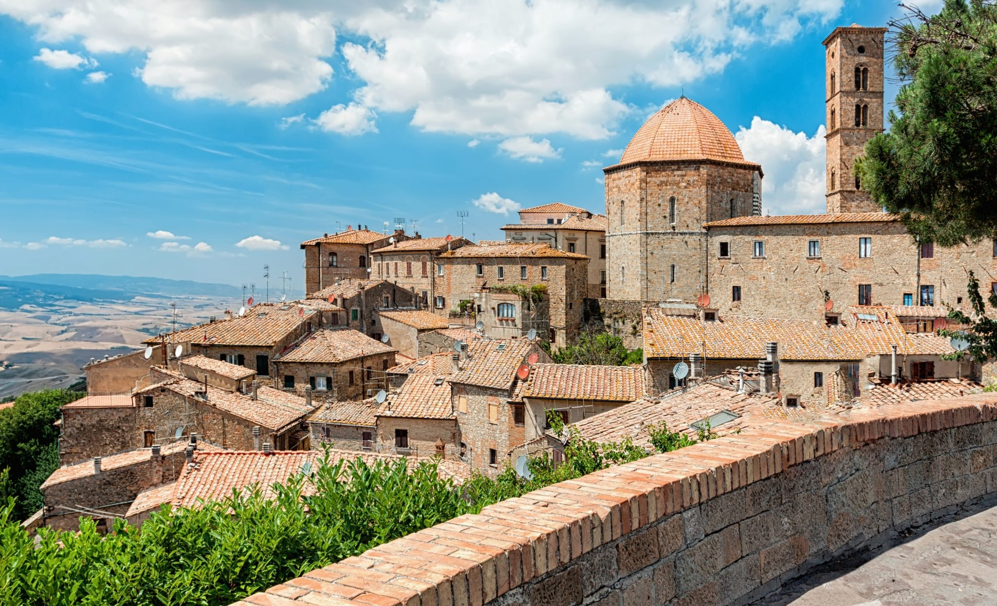 view of volterra italy from balcony overlooking town, one of the best things to do in volterra