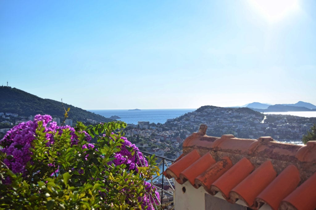 view from an apartment in dubrovnik with water in the distance--this apartment easily fit into our croatia travel budget