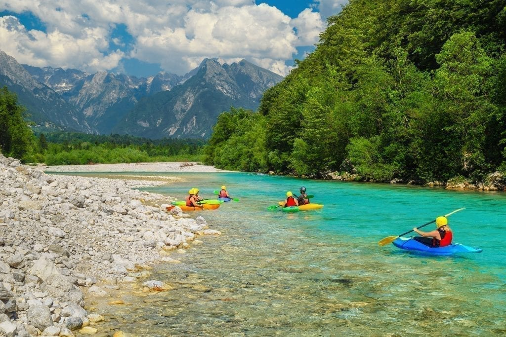 Kayakers in the Soca River in Slovenia, one of the most beautiful places in Slovenia