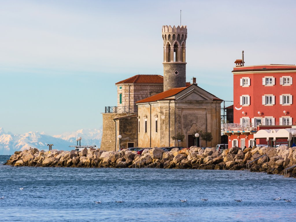 piran lighthouse as seen from across the water