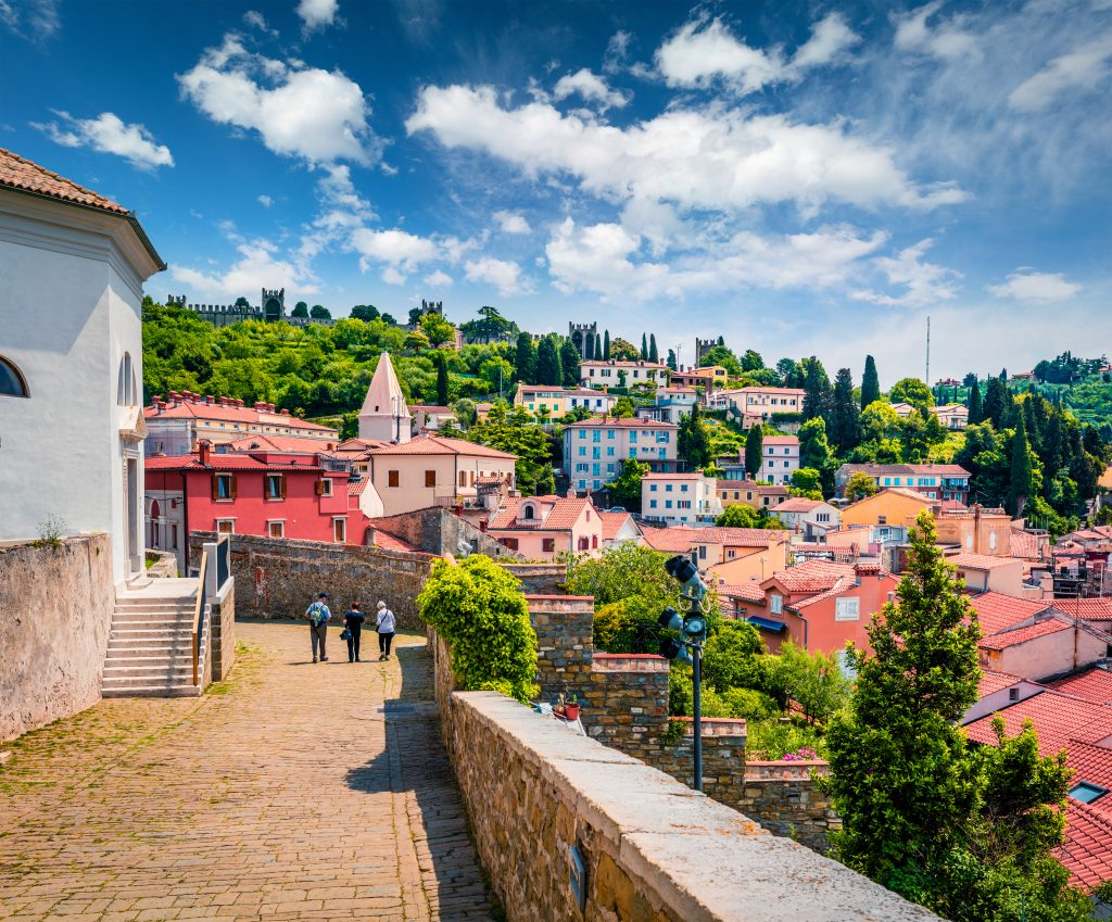 view of buildings of piran slovenia seen near st georges church, one of the best things to do in piran slovenia
