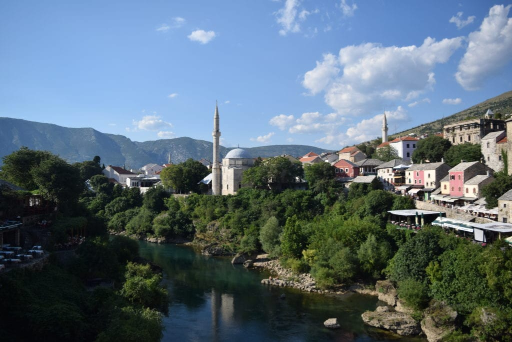 view of mostar bosnia from across the river, how to use airbnb can come in handy in the balkans
