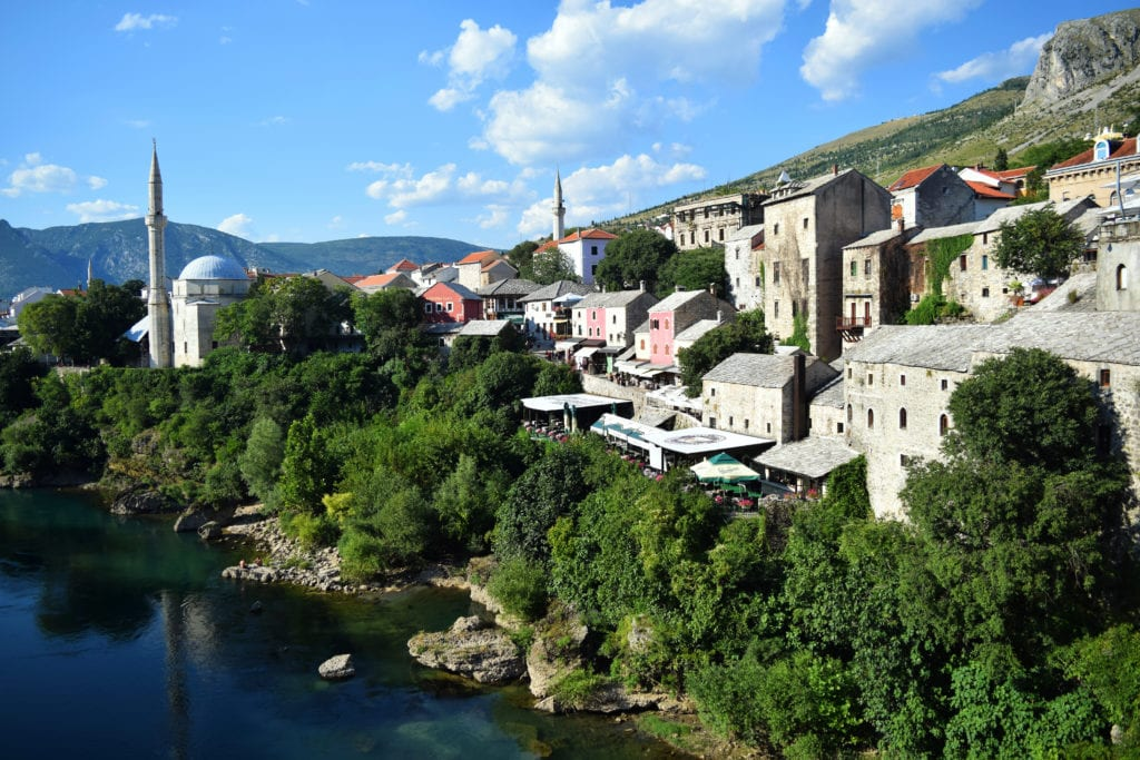 Photo of Mostar old town from the old bridge, added to a post about the best short travel quotes and travel captions
