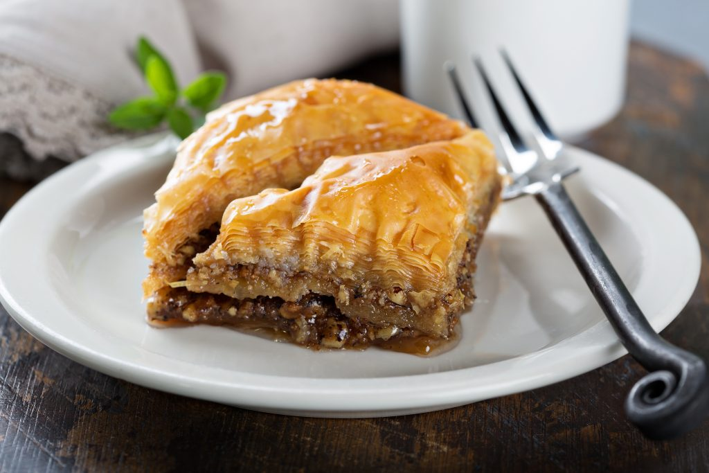 white plate with 2 triangles of baklava
