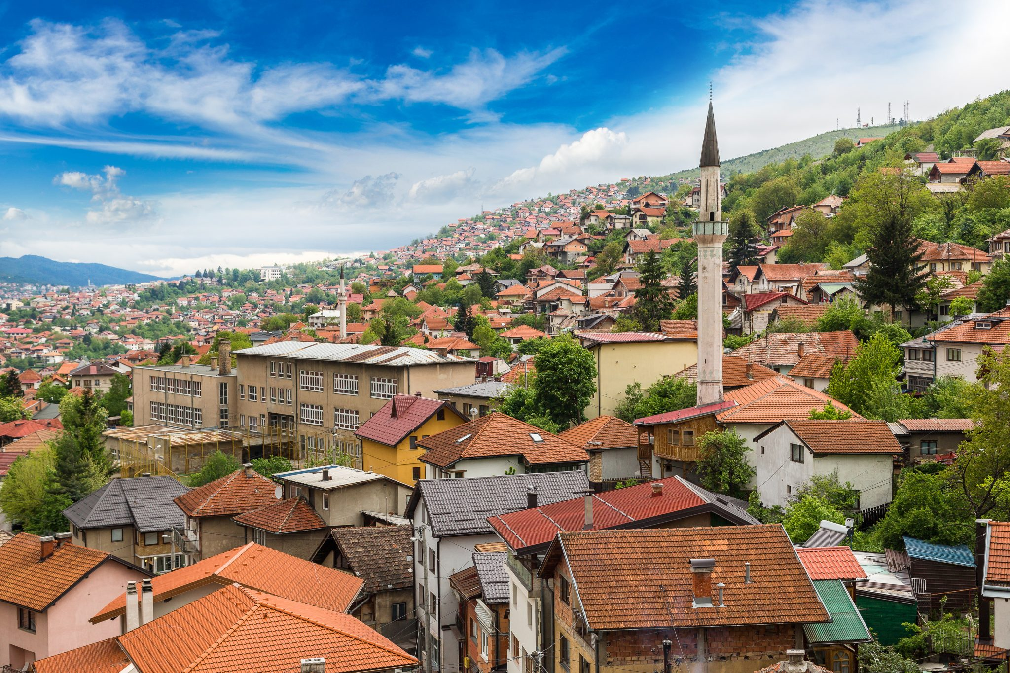 view of sarajevo bosnia and herzegovina skyline on a sunny day with a minaret prominent. old town is packed with some of the best things to do in sarajevo