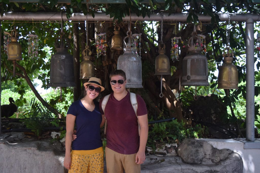 kate storm and jeremy storm in front of a collection of jars, wearing comfortable clothing--an essential bangkok travel tips