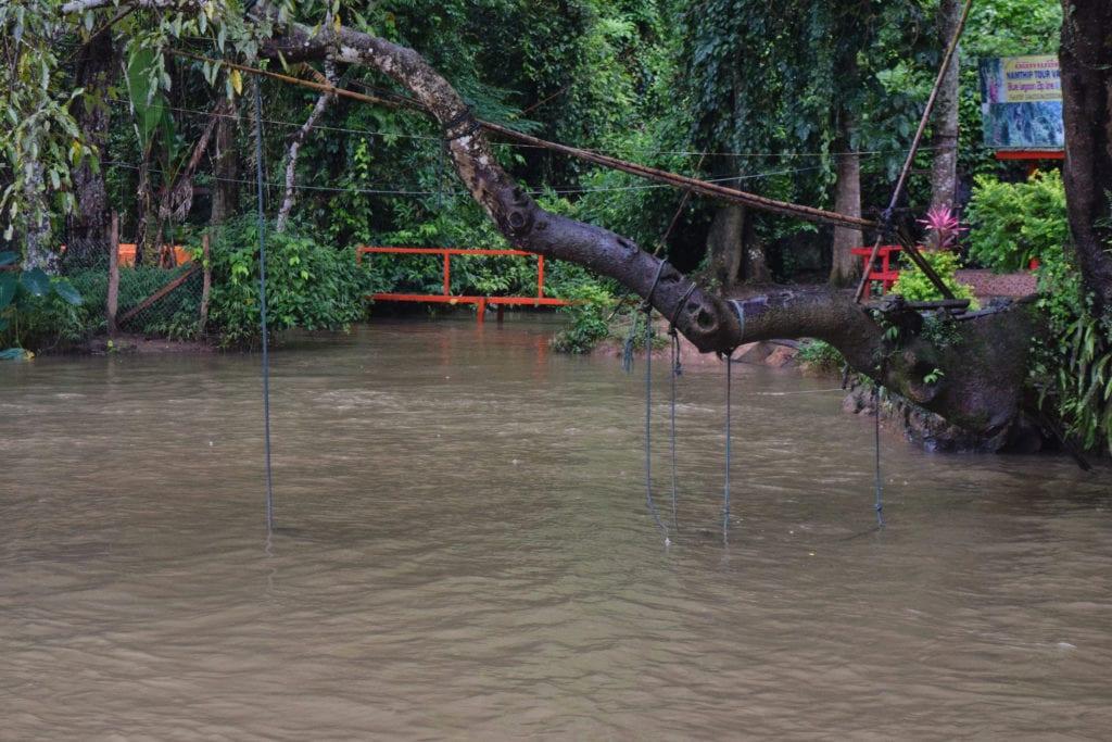 blue lagoon vang vieng during the rainy season in laos