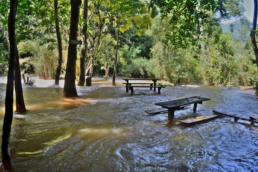 flooded picnic area at kuang si during the laos rainy season