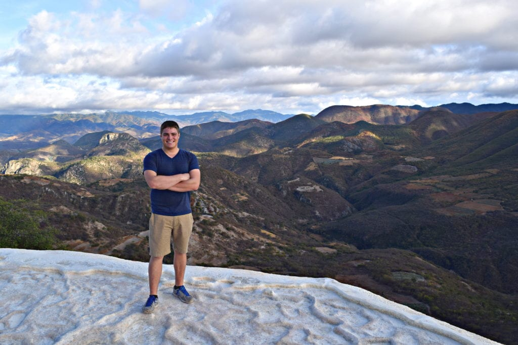 jeremy storm standing on the edge of hierve el agua as an american backpacking mexico