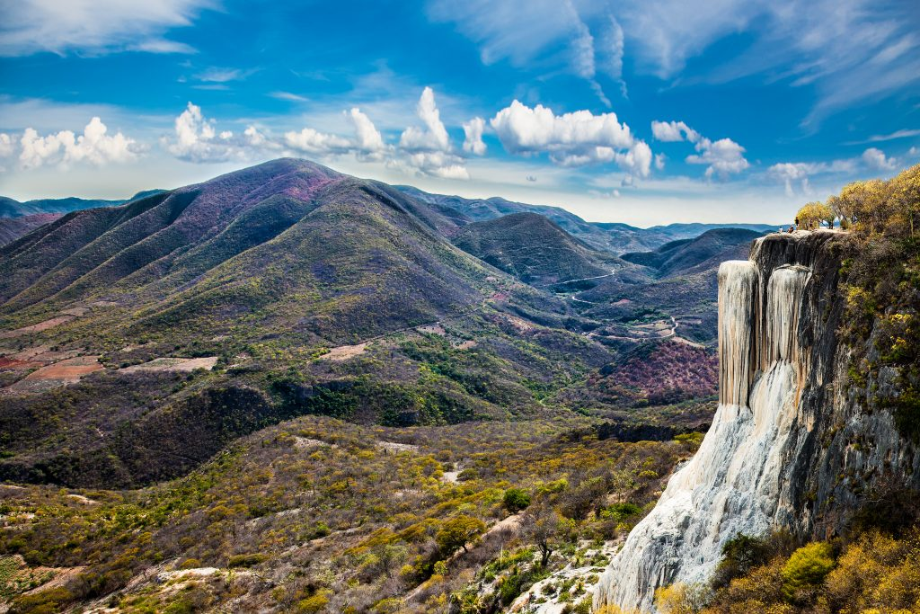 hierve el agua in oaxaca mexico with petrfied falls on the right side of the photo