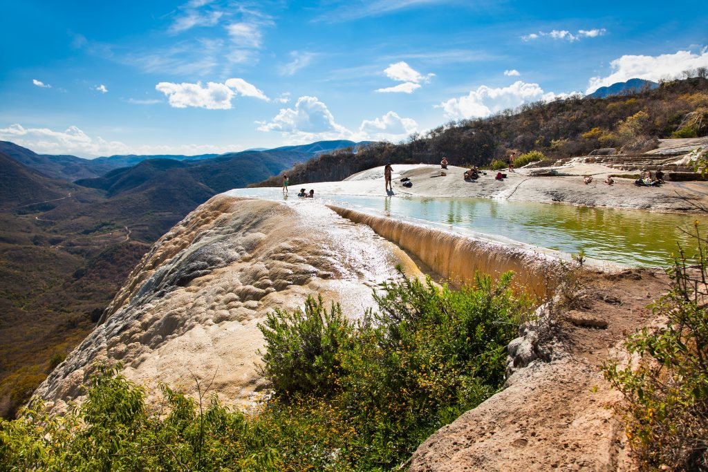 pool of hierve el agua on a sunny day, one of the best places to visit in oaxaca