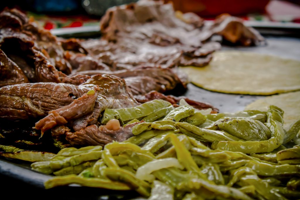 chiles meat and tortilla on a grill in mexico
