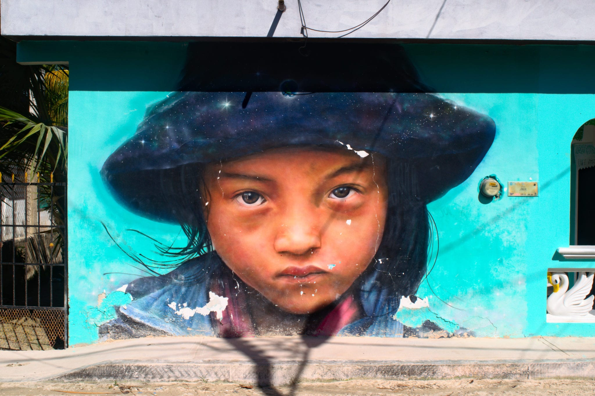 mural of a young girl on isla holbox, as seen while backpacking mexico americans