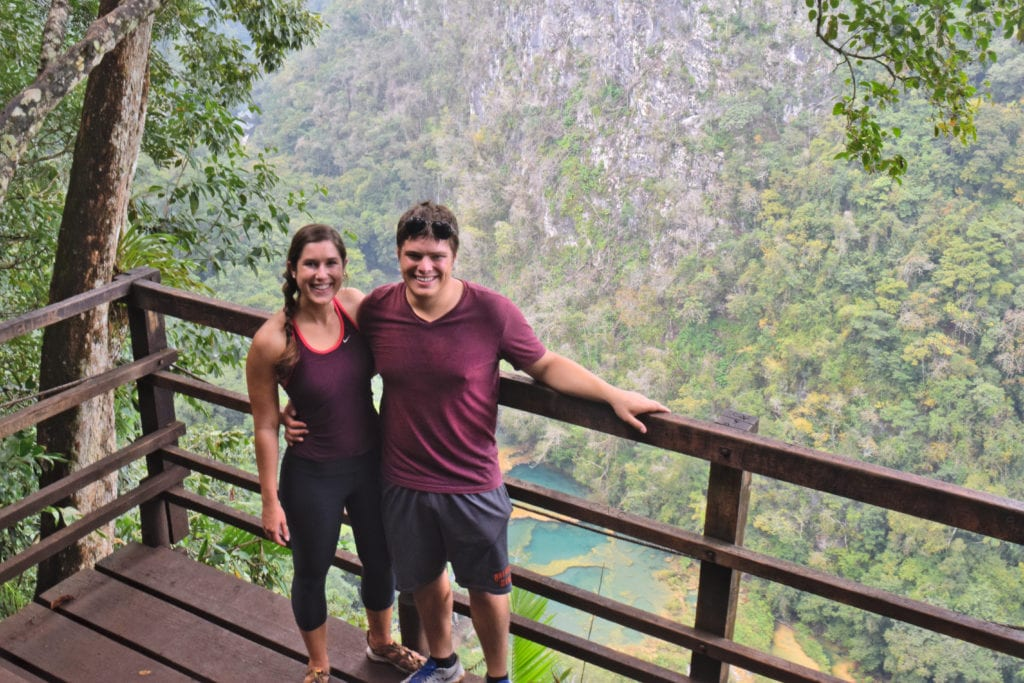 kate storm and jeremy storm standing on a deck overlooking semuc champey during 2 weeks in guatemala itinerary