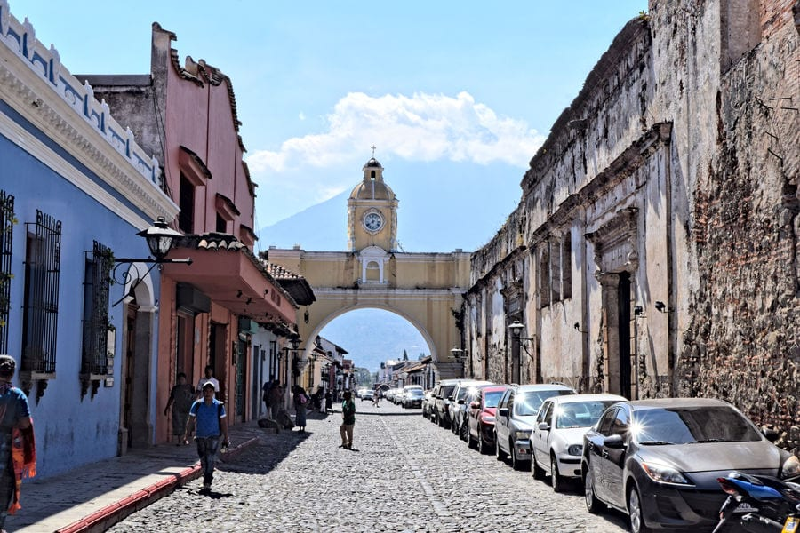 view of famous yellow gate in antigua guatemala, as seen during guatemala in 2 weeks itinerary