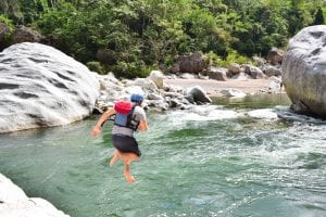 jeremy storm jumping into rio cangrejal during a trip whitewater rafting in honduras