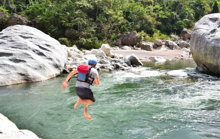 Whitewater Rafting in Honduras: Guy jumping into Rio Cangrejal