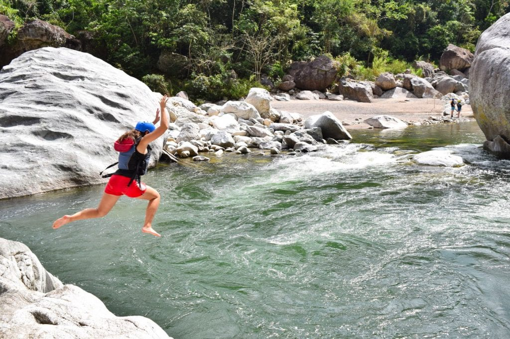 Packing List for Central America and Mexico: Girl Jumping into River