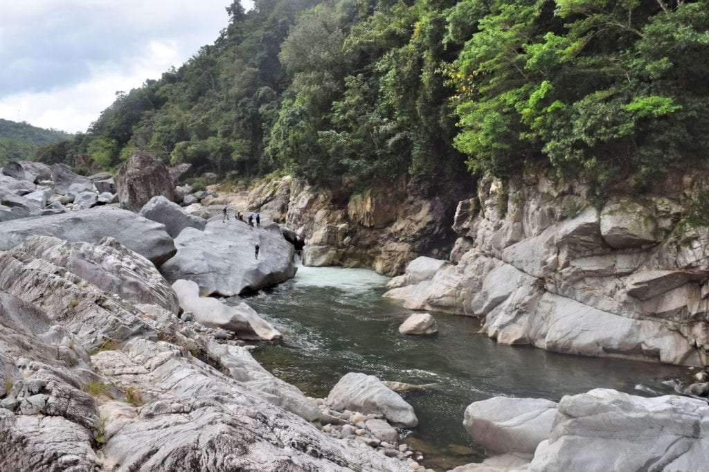 River Cangrejal in where we went white water rafting in Honduras, with river to the right side of the photo