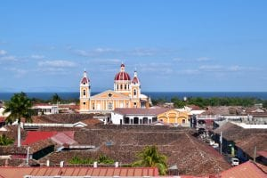 view of yellow and red church in granada nicaragua from above, an essential stop on a 2 weeks in nicaragua itinerary