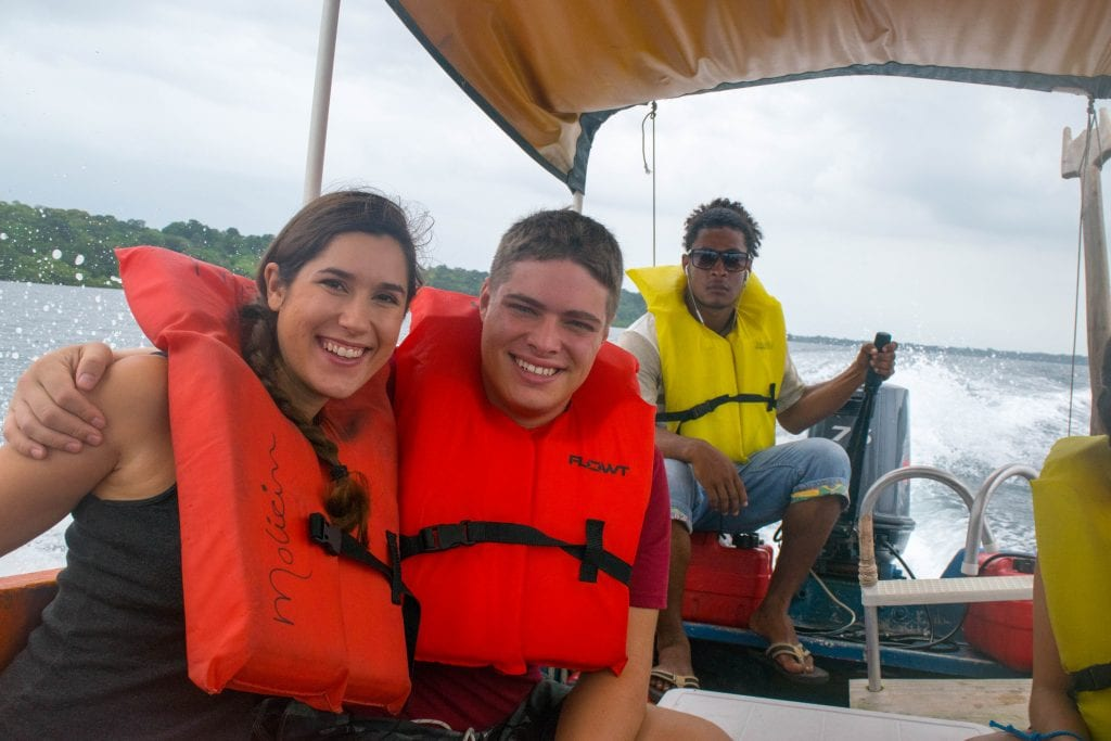 selfie of kate storm and jeremy storm on a boat wearing life jackets when visiting bocas del toro panama