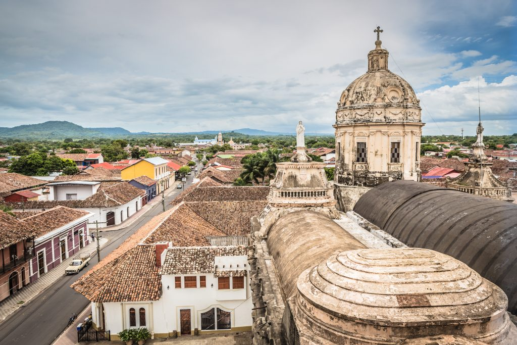 view of the rooftops of granada nicaragua with a church in the foreground