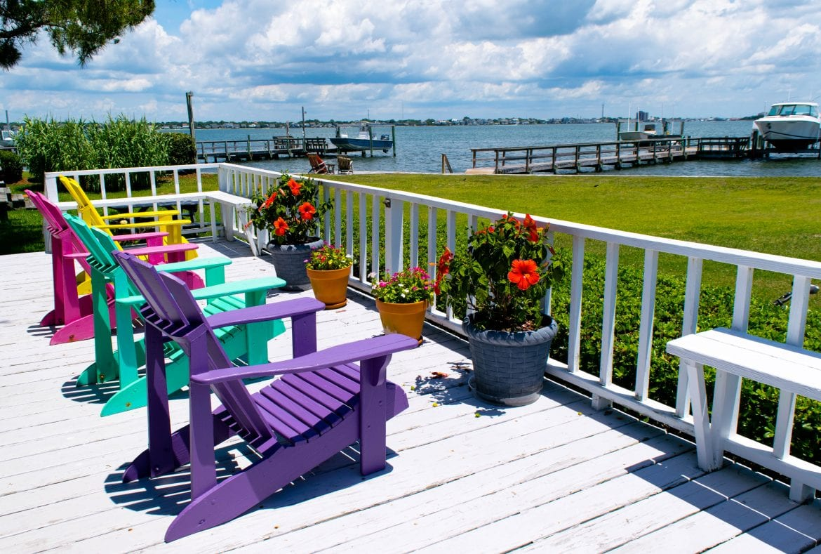Fun Things to Do in Beaufort NC: colorful beach chairs overlooking docks