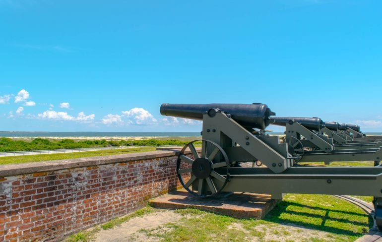 Cannons overlooking Fort Macon NC with the beach visible in the distance