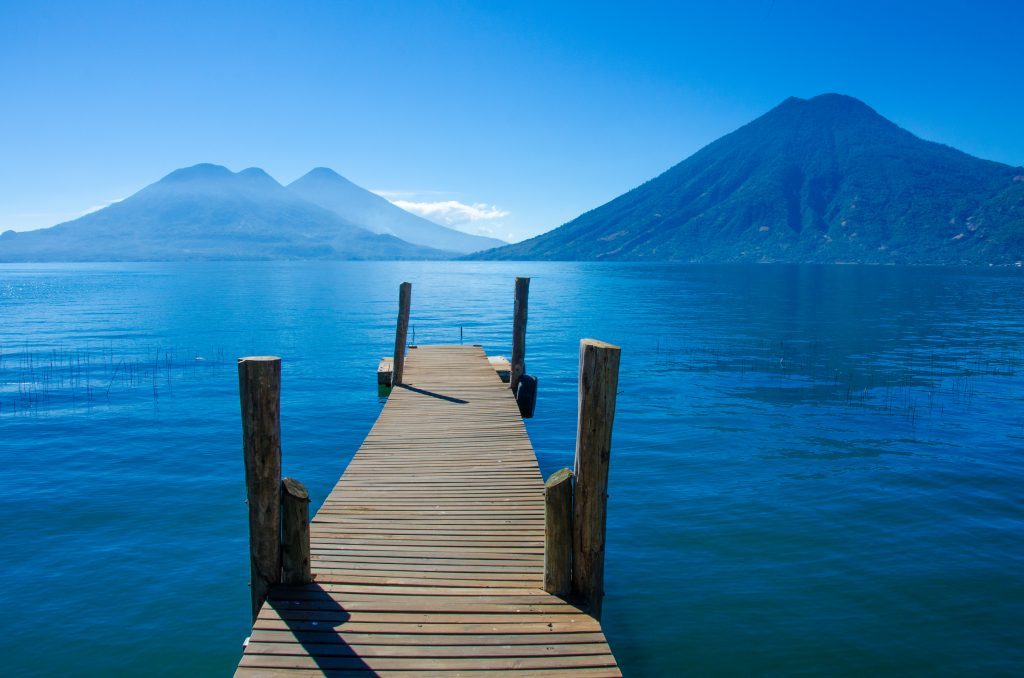 view of lake atitlan guatemala as seen from a pier on a guatemala vacation