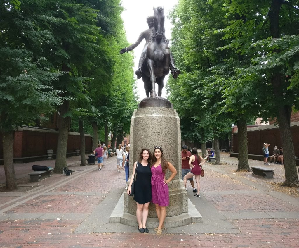 Kate Storm with a friend standing next to the Paul Revere statue in the North End in Boston MA