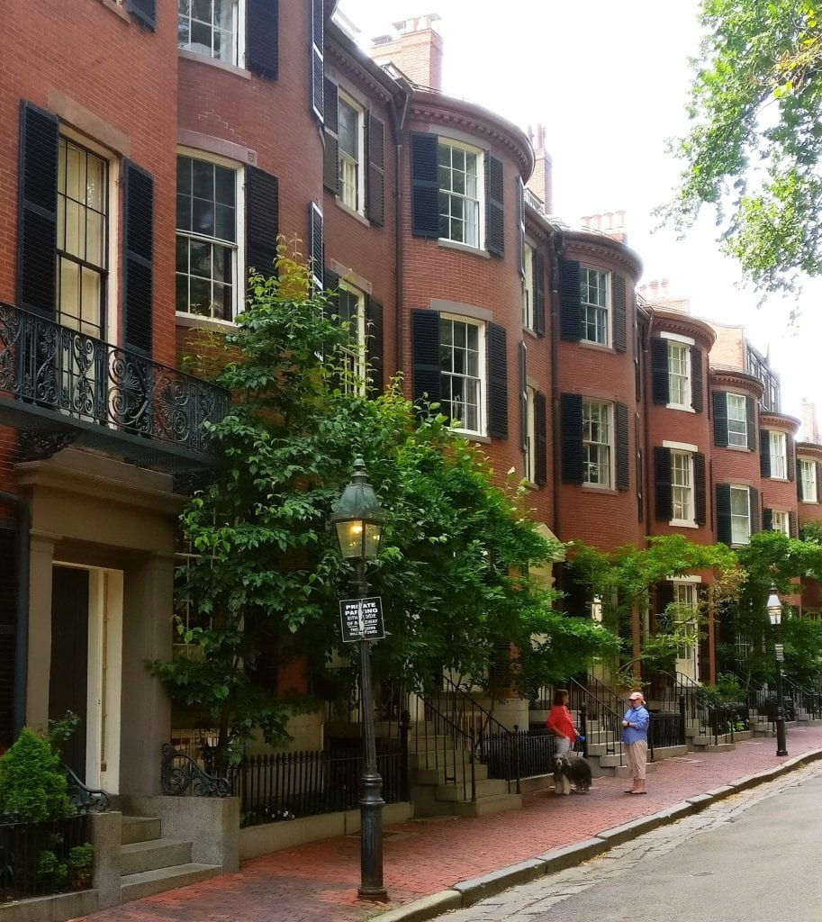 Street in Beacon HIll with red brick mansions, one of the best things to see in Boston MA