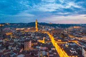 Florence Italy skyline at blue hour with Piazza Signoria lit up in the distance, an unforgettable addition to a Florence itinerary